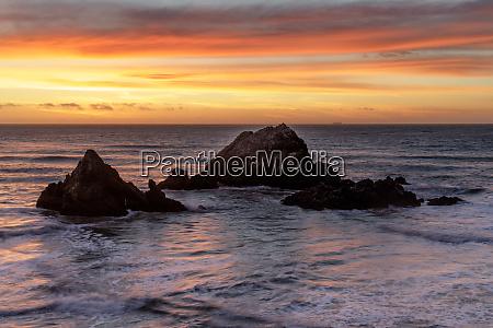 seal rocks islands winter sunset