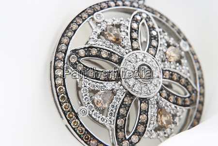 white gold pendant with diamonds on