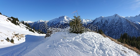 snow covered avalanche protection barrier in