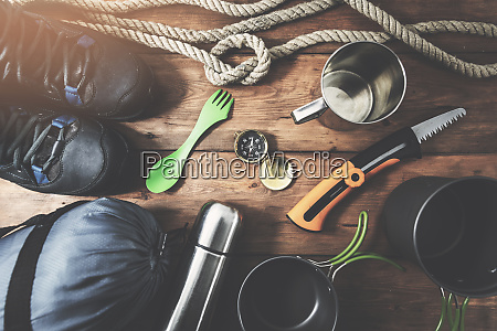 expedition camping equipment on wooden plank