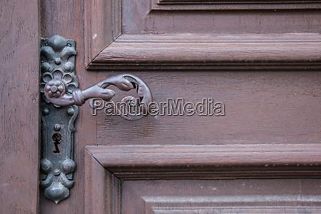 iron door handle of an old