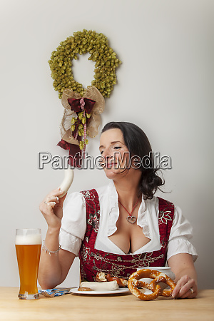 bavarian woman in a dirndl eating
