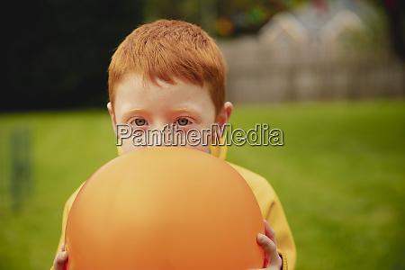 headshot of a little boy holding