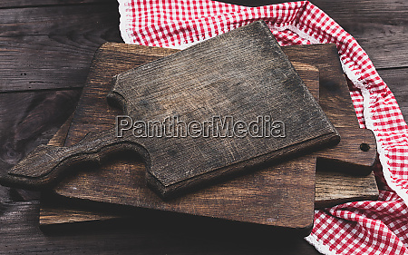 stack of old wooden kitchen chopping