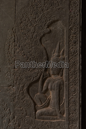 bas relief of seated woman in