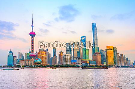 shanghai metropolis skyline at sunset