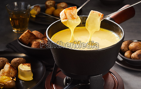dipping into a gourmet cheese fondue