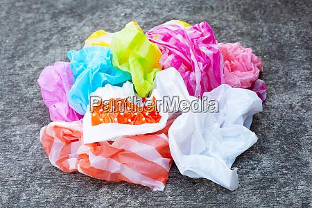 plastic bags waste on cement floor