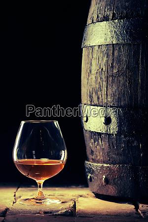 neat scotch in a snifter alongside