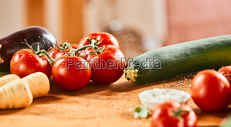 assorted fresh vegetables on a wooden