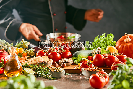 chef cooking with fresh vegetables and