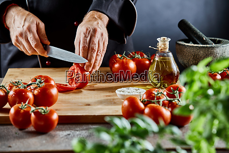 hands of a chef slicing a