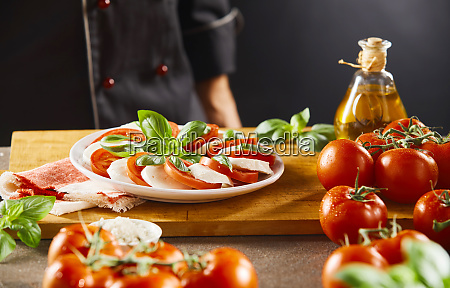 chef looking at a fresh caprese
