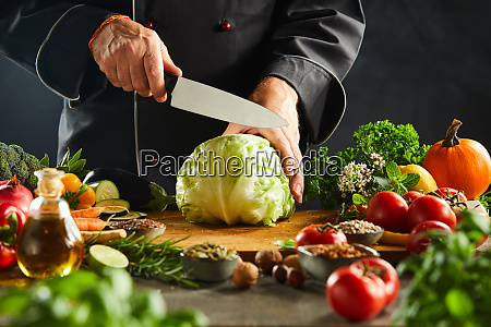 chef preparing to slice a fresh