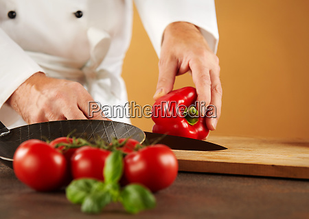chef cutting a fresh red sweet
