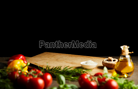 fresh cooking ingredients around a wooden