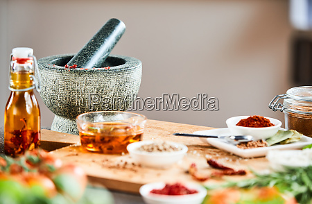 stone pestle and mortar with herbs