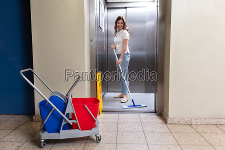 janitor cleaning elevator