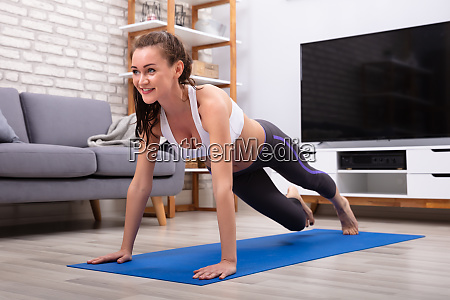 woman doing push up exercise