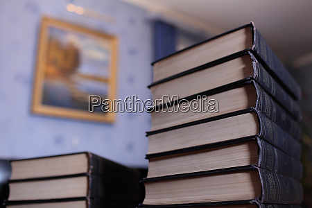 high stack of books on the