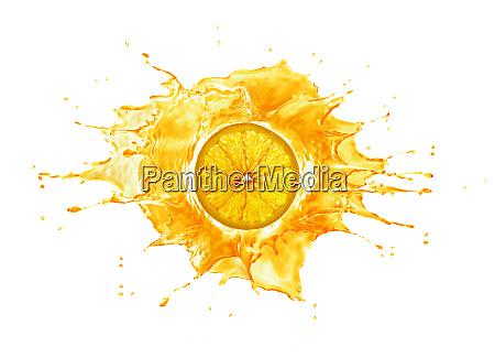 splash with orange slice in the