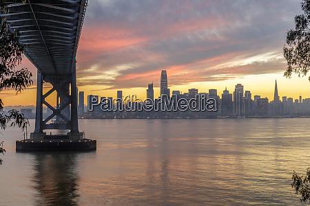 under the bridge winter sunset over