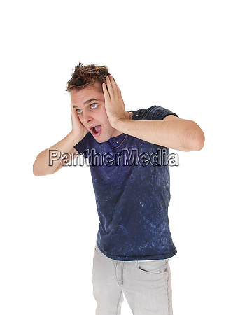 young man screaming with hands on