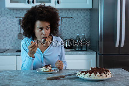 young woman eating a piece of