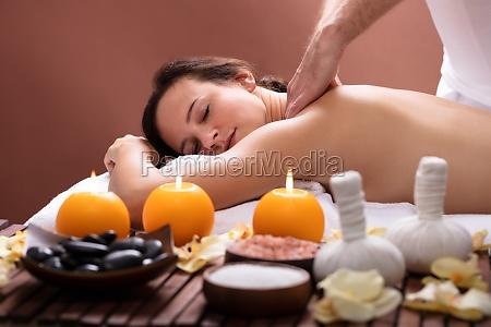 therapist massaging womans back