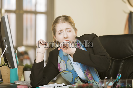 exhausted or bored woman yawning at