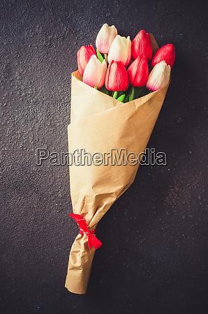 bouquet of tulips on dark background