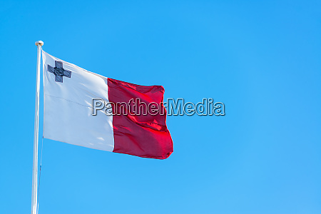 maltese flag and blue sky
