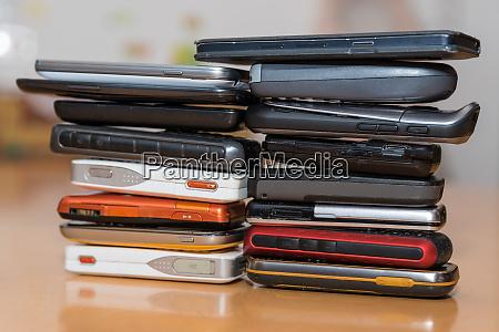 numerous smartphones stacked