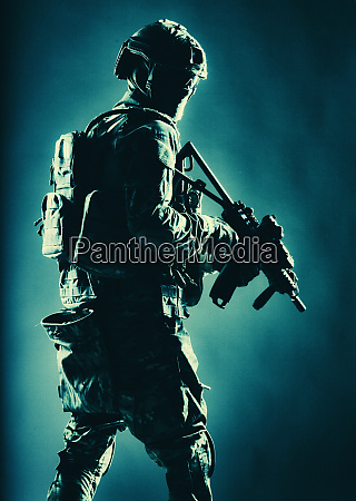 special operations forces soldier in darkness