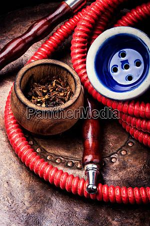 smoking hookah with tobacco