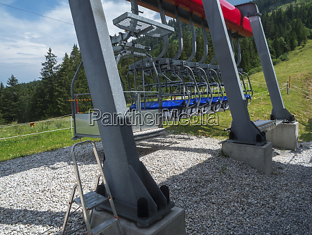 parked chairlifts in the summer