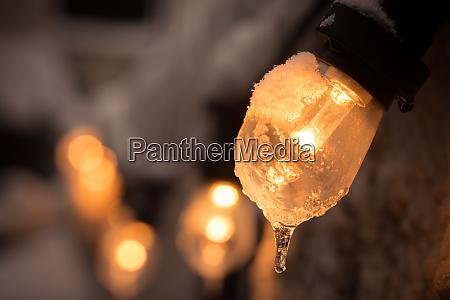 frozen lit light bulb