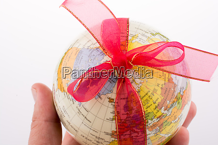 globe tied with ribbon
