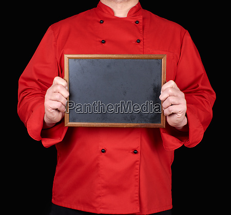 chef in red uniform holding an