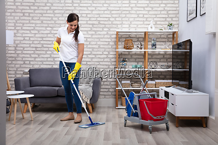 janitor cleaning floor with mop
