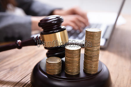 stack of increasing coins on gavel