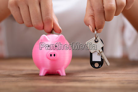 person holding keys inserting coin in