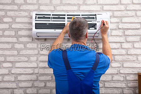 electrician checking air conditioner