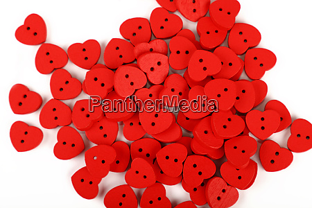 red heart shaped sewing buttons over
