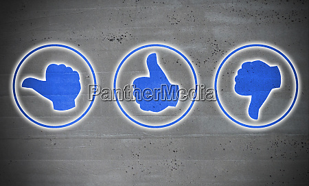 thumb rating icons on cement concept