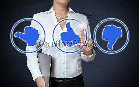 thumb icons touchscreen shown by businesswoman