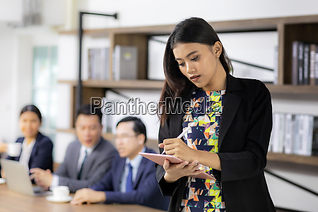 asian businesswoman working with smart tablet
