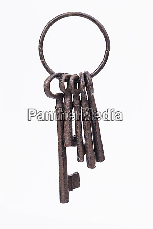 old rustic keyring isolated on white