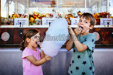 children eating cotton candy at the