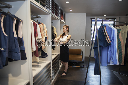 japanese saleswoman standing in clothing store